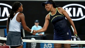 "United States' Venus Williams, right, congratulates compatriot Cori ""Coco"" Gauff on winning their first round singles match at the Australian Open tennis championship in Melbourne, Australia, Monday, Jan. 20, 2020. (AP Photo/Dita Alangkara)"