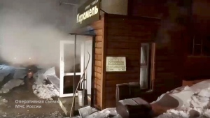 In this image made from video provided by Russian Emergency Situations Ministry press service, shows a view of a damaged hotel of nine rooms located in the basement of a residential building which was flooded with boiling water after a pipe ruptured in Perm, Russia, Monday, Jan. 20, 2020. Russian emergency services say heating pipe damage caused deaths and injuries. (Ministry of Emergency Situations press service via AP)