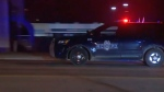 In this image made from video, a police vehicle passes with sirens near the scene of a shooting, Jan. 20, 2020, in Kansas City, Missouri. Police say at least two people are dead and upwards of a dozen people may have been injured in a shooting outside a bar. (KMBC via AP)