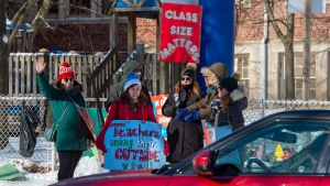 Striking teachers from Williamson Road Junior Public School in Toronto cheer as passing cars honk their horns in support on Monday, January 20, 2020. THE CANADIAN PRESS/Frank Gunn