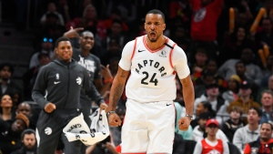 Toronto Raptors guard Norman Powell reacts toward the Atlanta Hawks bench after scoring during the second half of an NBA basketball game Monday, Jan. 20, 2020, in Atlanta. Toronto won 122-117.(AP Photo/John Amis)