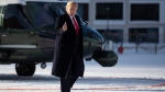 US President Donald Trump gestures as he arrives in Davos, Switzerland on Marine One, Tuesday, Jan. 21, 2020. President Trump arrived in Switzerland on Tuesday to start a two-day visit to the World Economic Forum. (AP Photo/Evan Vucci)
