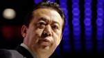 In this July 4, 2017, file photo, Interpol President Meng Hongwei delivers his opening address at the Interpol World Congress, in Singapore. China announced Wednesday April 25, 2019 that it has formally arrested former Interpol President Meng Hongwei on suspicion of accepting bribes.. (AP Photo/Wong Maye-E, File)