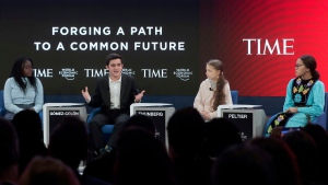 Swedish environmental activist Greta Thunberg, second right, Autumn Peltier, Chief Water Commissioner of the Anishinabek Nation, right, Salvador Gomez-Colon, founder of Light & Hope for Puerto Rico, second left, and Natasha Mwansa of the Natasha Mwansa Foundation, left, address the World Economic Forum in Davos, Switzerland, Tuesday, Jan. 21, 2020. The 50th annual meeting of the forum will take place in Davos from Jan. 20 until Jan. 24, 2020. (AP Photo/Markus Schreiber)