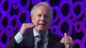 Jean Charest speaks during a panel discussion at the Canadian Aerospace Summit in Ottawa, Wednesday, Nov. 13, 2019. THE CANADIAN PRESS/Adrian Wyld