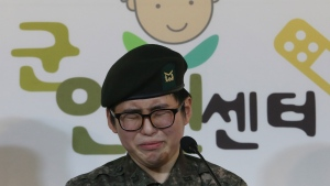"South Korean army Sergeant Byun Hui-su weeps during a press conference at the Center for Military Human Right Korea in Seoul, South Korea, Wednesday, Jan. 22, 2020. South Korea's military decided Wednesday to discharge Byun who recently undertook gender reassignment surgery, a ruling expected to draw strong criticism from human rights groups.The sign reads ""The Center for Military Human Right Korea."" (AP Photo/Ahn Young-joon)"