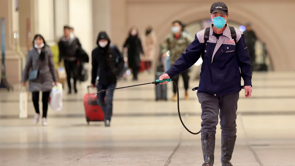 A worker sprays disinfectant at a train station in Wuhan in southern China's Hubei province, Wednesday, Jan. 22, 2020. Chinese health authorities urged people in the city of Wuhan to avoid crowds and public gatherings, after warning on Wednesday that a new viral illness that has infected hundreds and caused at least nine deaths could spread further. (Chinatopix via AP)