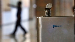 A student walks in the hallway past a water fountain in this file photo. (AP Photo/Paul Sancya)