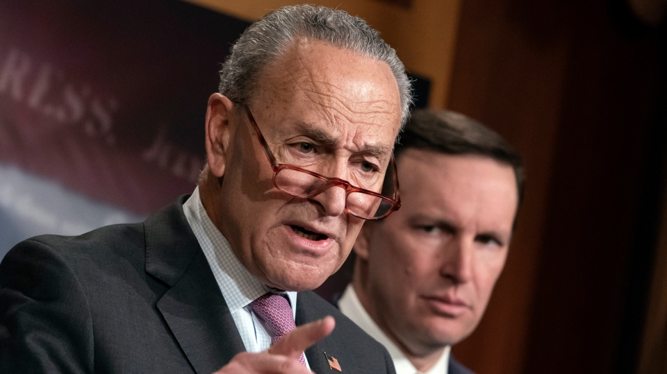 Senate Minority Leader Chuck Schumer, D-N.Y., joined by Sen. Chris Murphy, D-Conn., speaks during a news conference at the Capitol in Washington, Wednesday, Jan. 22, 2020. (AP Photo/J. Scott Applewhite)
