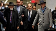 Harvey Weinstein, center, accompanied by attorney Arthur Aidala, right, arrives at court for his rape trial, in New York, Wednesday, Jan. 22, 2020. (AP Photo/Richard Drew)