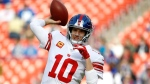 FILE - In this Dec. 22, 2019 file photo New York Giants quarterback Eli Manning works out prior to an NFL football game against the Washington Redskins in Landover, Md. Manning, who led the Giants to two Super Bowls in a 16-year career that saw him set almost every team passing record, has retired. (AP Photo/Patrick Semansky, file)