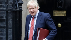 Britain's Prime Minister Boris Johnson leaves 10 Downing Street to attend the weekly session of Prime Minister's Questions in Parliament in London, Wednesday, Jan. 22, 2020. (AP Photo/Kirsty Wigglesworth)