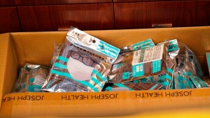 A box of masks imported from Japan sits inside a Yifeng Pharmacy in Wuhan, China, Wednesday, Jan. 22, 2020. Pharmacies in Wuhan are restricting customers to buying one mask at a time amid high demand and worries over an outbreak of a new coronavirus. The number of cases of the new virus has risen to over 400 in China and the death toll to 9, Chinese health authorities said Wednesday. (AP Photo/Dake Kang)