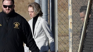 Michelle Carter leaves the Bristol County jail, Thursday, Jan. 23, 2020, in Dartmouth, Mass., after serving most of a 15-month manslaughter sentence for urging her suicidal boyfriend to kill himself in 2014. The 23-year-old, released three months early for good behavior, will serve five years of probation. (AP Photo/Steven Senne)