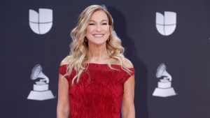 FILE - This Nov. 14, 2019 file photo shows Grammys CEO Deborah Dugan at the 20th Latin Grammy Awards in Las Vegas. Dugan has fired back at the Recording Academy with a complaint claiming she was retaliated against after reporting she was subjected to sexual harassment and gender discrimination during her six-month tenure. Lawyers for Dugan, who the academy placed on administrative leave last week, filed a discrimination case with the Equal Employment Opportunity Commission on Tuesday. In the complaint, she claims she was subjected to sexual harassment from the academy's general counsel. (Photo by Eric Jamison/Invision/AP, File)