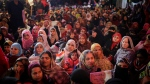 In this Saturday, Jan. 18, 2020 photo, women protesters listen to a speaker inside a tent at the protest site in New Delhi's Shaheen Bagh area, India. (AP Photo/Altaf Qadri)