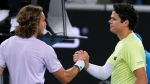 Canada's Milos Raonic, right, is congratulated by Greece's Stefanos Tsitsipas after winning their third round singles match at the Australian Open tennis championship in Melbourne, Australia, Friday, Jan. 24, 2020. (AP Photo/Andy Wong)