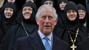Britain's Prince Charles poses with nuns and clergymen at the Russian Orthodox Church of Mary Magdalene on the Mount of Olives on Friday, Jan. 24, 2020 in Jerusalem. (Ahmad Gharabli/Pool Photo via AP)