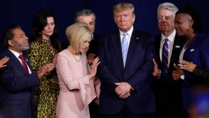 In this Jan. 3, 2020, file photo, faith leaders pray with President Donald Trump during a rally for evangelical supporters at the King Jesus International Ministry church in Miami. (AP Photo/Lynne Sladky, File)