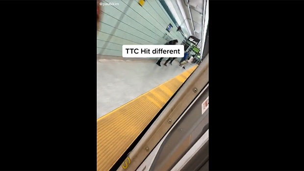 This still image taken from a video uploaded to Tik Tok appears to show a damaged door on a subway train.