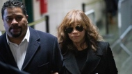 Actress Rosie Perez leaves the courtroom after testifying in the rape trial of Harvey Weinstein, Friday, Jan. 24, 2020 in New York. (AP Photo/Mark Lennihan)