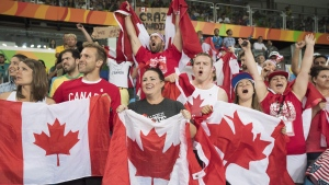 Fans of Canada's Erica Wiebe, of Stittsville, Ont., react during her gold medal match against Kazakhstan's Guzel Manyurova in the women's 75kg women's freestyle wrestling at the 2016 Summer Olympics in Rio de Janeiro, Brazil, Thursday, Aug. 18, 2016. THE CANADIAN PRESS/Ryan Remiorz