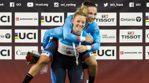 Kelsey Mitchell, front and Lauriane Genest react after winning gold in the women's team sprintduring Tissot UCI Track Cycling World Cup in Milton, Ont., on Friday, January 24, 2020. THE CANADIAN PRESS/Nathan Denette