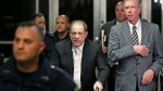 Defendant Harvey Weinstein, center, leaves the courthouse following the second day of his rape trial, Thursday, Jan. 23, 2020, in New York. (AP Photo/Kathy Willens)