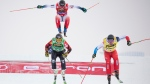 Ryan Regez of Switzerland,, right, Brady Leman of Canada, left, and Francois Place of France cross the finish line during the FIS World Cup Men's Freestyle Skicross final in Idre, Sweden, Saturday. Jan. 25, 2020. (Pontus Lundahl / TT via AP)