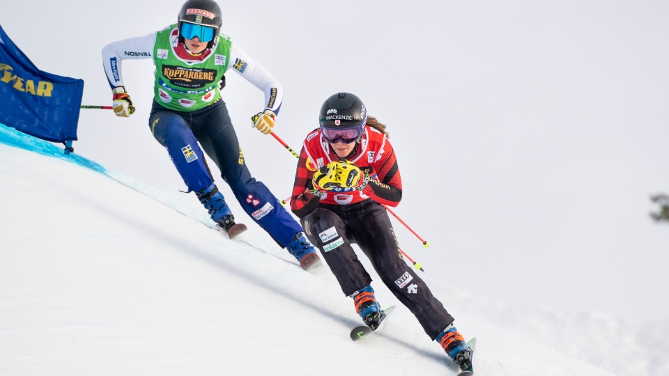 Brittany Phelan of Canada followed by Alexandra Edebo of Sweden during the FIS World Cup Women's Freestyle Skicross competition in Idre, Sweden,Saturday. Jan. 25, 2020. (Pontus Lundahl / TT via AP)