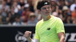 Canada's Milos Raonic reacts after defeating Croatia's Marin Cilic in their fourth round singles match at the Australian Open tennis championship in Melbourne, Australia, Sunday, Jan. 26, 2020. (AP Photo/Dita Alangkara)