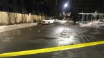 A white sedan and evidence markers are seen outside an apartment building on Wilson Avenue on Jan. 26, 2020. (Cristina Tenaglia/CP24)