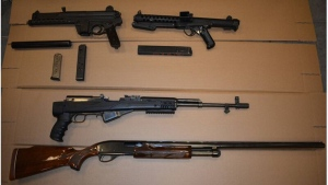 Guns including a 9mm Sterling Submachine gun (top right) are shown in Toronto police handout image. (TPS)