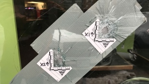 Bullet holes are seen in the window of a store near Markham and Kingston roads. (Nick Dixon/CTV News Toronto)