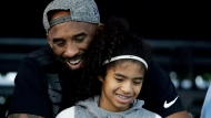 Former Los Angeles Laker Kobe Bryant and his daughter Gianna watch during the U.S. national championships swimming meet Thursday, July 26, 2018, in Irvine, Calif. (AP Photo/Chris Carlson)