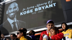 Fans mourn the loss of Kobe Bryant in front of La Live across from Staples Center, home of the Los Angeles Lakers in Los Angeles on Sunday, Jan. 26, 2020. (Keith Birmingham/The Orange County Register via AP)