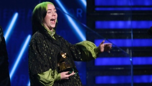 "Billie Eilish accepts the award for record of the year for ""Bad Guy"" at the 62nd annual Grammy Awards on Sunday, Jan. 26, 2020, in Los Angeles. (Photo by Matt Sayles/Invision/AP)"