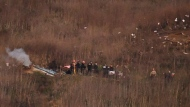 A body is carried from the scene of a helicopter crash that killed former NBA basketball player Kobe Bryant, his daughter and several others in Calabasas, Calif., Sunday, Jan. 26, 2020. (AP Photo/Kelvin Kuo)