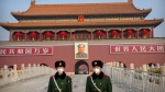 Paramilitary police wear face masks as they stand guard at Tiananmen Gate adjacent to Tiananmen Square in Beijing, Monday, Jan. 27, 2020. China on Monday expanded sweeping efforts to contain a viral disease by postponing the end of this week's Lunar New Year holiday to keep the public at home and avoid spreading infection as the death toll rose to 80. (AP Photo/Mark Schiefelbein)