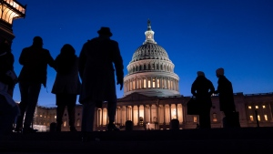 In this Jan. 22, 2020 file photo, night falls on the Capitol, in Washington during the impeachment trial of President Donald Trump. For all the gravity of a presidential impeachment trial, Americans don't seem to be giving it much weight. Web traffic and TV ratings tell a similar story, with public interest seeming to flag after the House voted last month to impeach a president for only the third time in U.S. history.  (AP Photo/J. Scott Applewhite, File)
