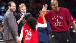 Los Angeles Lakers Kobe Bryant (24) high-fives his daughter Gianna on the court in warm-ups before first half NBA All-Star Game basketball action in Toronto on Sunday, February 14, 2016. Kobe Bryant, the 18-time NBA All-Star who won five championships and became one of the greatest basketball players of his generation during a 20-year career with the Los Angeles Lakers, died in a helicopter crash Sunday. Bryant's 13-year-old daughter Gianna also was killed. THE CANADIAN PRESS/Mark Blinch