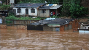 A view of flooded houses caused by heavy rains in Sabara municipality, Minas Gerais state, Brazil, Friday, Jan.24, 2020. Heavy rains caused flooding and landslides in southeast Brazil, killing at dozens of people, authorities said Saturday. (AP Photo/Flavio Tavares-Futura Press)