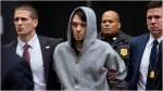 "FILE - In this Dec. 17, 2015, file photo, Martin Shkreli, center, the former hedge fund manager under fire for buying a pharmaceutical company and ratcheting up the price of a life-saving drug, is escorted by law enforcement agents in New York after being taken into custody following a securities probe. State and federal authorities sued the imprisoned drug entrepreneur Monday, Jan. 27, 2020, over business tactics that helped make him the bad-boy face of profiteering in the pharmaceuticals industry, seeking to bar the so-called ""Pharma Bro"" from the industry for life. (AP Photo/Craig Ruttle, File)"