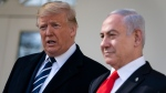 President Donald Trump and Israeli Prime Minister Benjamin Netanyahu talk with reporters before a meeting in the Oval Office of the White House, Monday, Jan. 27, 2020, in Washington. (AP Photo/ Evan Vucci)