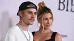 "Justin Bieber and Hailey Baldwin arrive at the Los Angeles premiere of ""Justin Bieber: Seasons,"" Monday, Jan. 27, 2020. Justin Bieber has announced his new album title, release date and tour stops. The pop star from Stratford, Ont., says the album ""Changes"" will come out Feb. 14. THE CANADIAN PRESS/AP, Jordan Strauss/Invision"