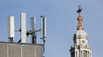 Mobile network phone masts are visible in front of St Paul's Cathedral in the City of London, Tuesday, Jan. 28, 2020. (AP Photo/Alastair Grant)