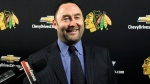Former Chicago Blackhawks goaltender Ed Belfour smiles as he talks to media before the Nashville Predators play against the Chicago Blackhawks NHL hockey game in Chicago, Sunday, March 25, 2012. (AP Photo/Nam Y. Huh)