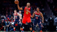 Atlanta Hawks guard Vince Carter (15) looks to pass as Washington Wizards guard Ish Smith (14) defends during the second half of an NBA basketball game on Sunday, Jan. 26, 2020, in Atlanta. (AP Photo/Todd Kirkland)