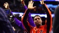 Toronto Raptors guard Kyle Lowry acknowledges the crowd as they cheer after him becoming the all-time franchise leader in assists during the second half of NBA basketball action against the Atlanta Hawks in Toronto on Tuesday, January 28, 2020. THE CANADIAN PRESS/Frank Gunn