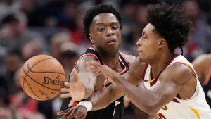 Cleveland Cavaliers' Collin Sexton, right, passes the ball past Toronto Raptors' OG Anunoby during the second half of an NBA basketball game Thursday, Jan. 30, 2020, in Cleveland. Toronto won 115-109. (AP Photo/Tony Dejak)